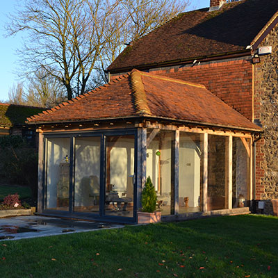 michael miller testimonial for spicertiles photo of kent roof tiles on house extension going into the back garden.