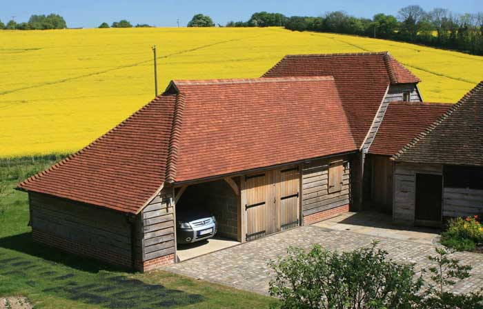 A garage extension roof with our medium antique blend handmade clay roof tiles in the countryside.